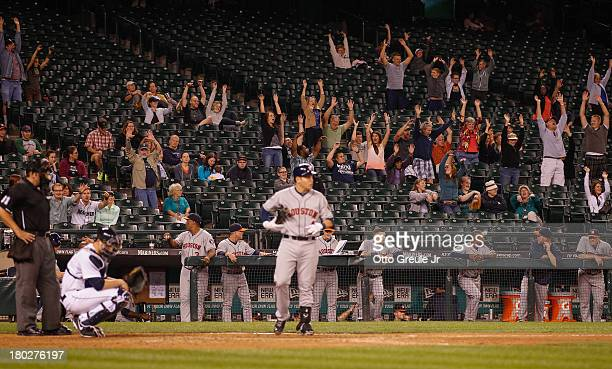 A sparse crowd does the wave as Brandon Laird of the Houston Astros stands in to bat in the ninth inning against the Seattle Mariners at Safeco Field...