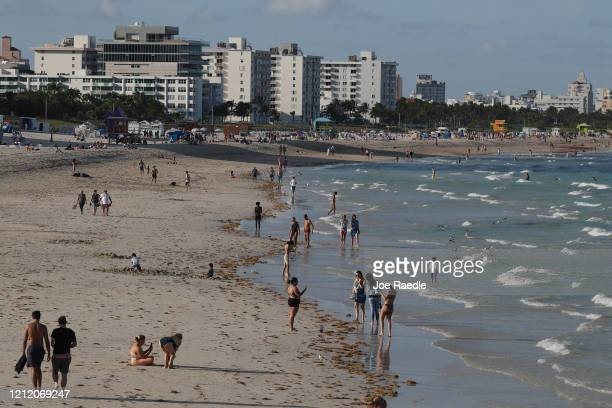 A sparsely attended beach is seen as the city announces a state of emergency to try and prevent the spread of the coronavirus on March 12 2020 in...