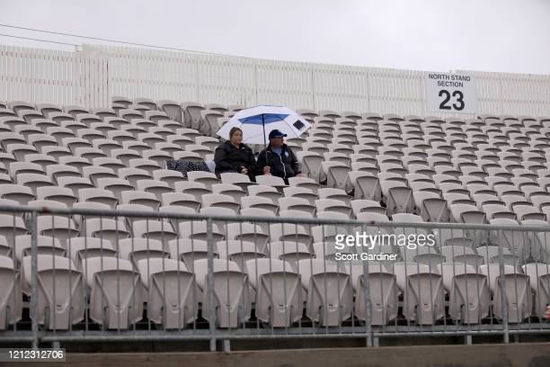 Sparsely populated stands as ALeague fans brave the rain and the ongoing threat of the coronavirus outbreak during the round 23 ALeague match between...