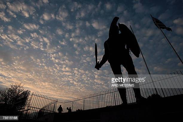 A statue of King Leonidas of ancient Sparta towers over the sports stadium of modern Sparta some 200 kilometres south of Athens 07 March 2007 The...