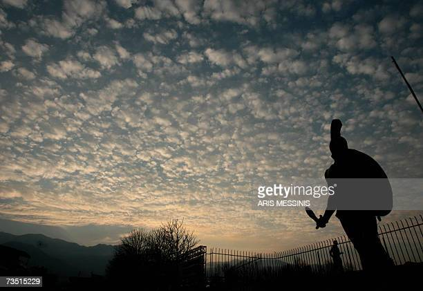 A statue of King Leonidas of ancient Sparta towers over the sports stadium of modern Sparta some 200 kilometres south of Athens in this picture taken...