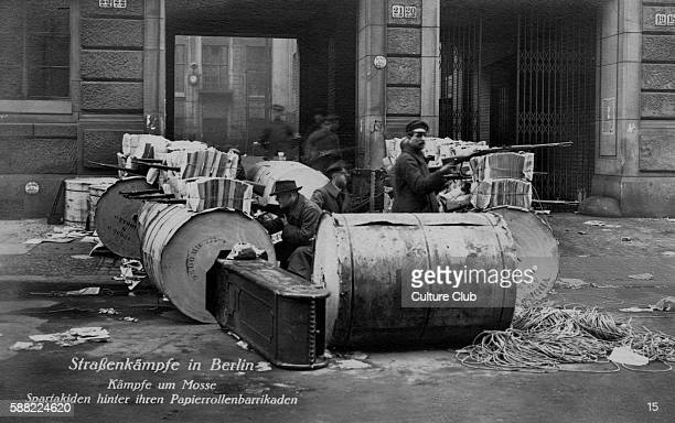 Street battles in Berlin Spartacists behind a paper roll barricade During Spartacist Uprising of German Revolution of November 1918 August 1919...