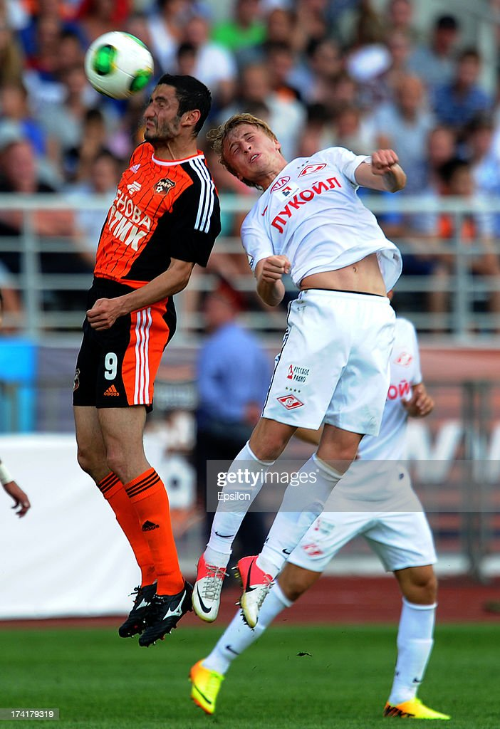 Spartak Gogniyev of FC Ural Sverdlovsk Oblast is challenged by Sergei Bryzgalov of FC Spartak Moscow during the Russian Premier League match betweenn FC Ural Sverdlovsk Oblast and FC Spartak Moscow at the Tcentralny Stadium on July 21, 2013 in Ekaterinburg, Russia.