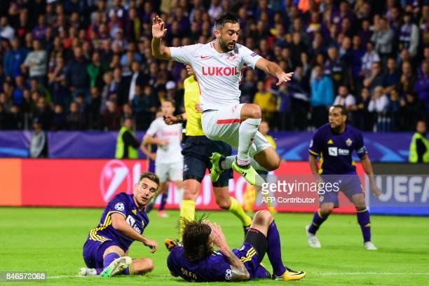 Spartak Moscow's Aleksandr Samedov leaps over NK Maribor's Marko Suler as Blaz Vrhovec looks on during the UEFA Champions League Group E football...