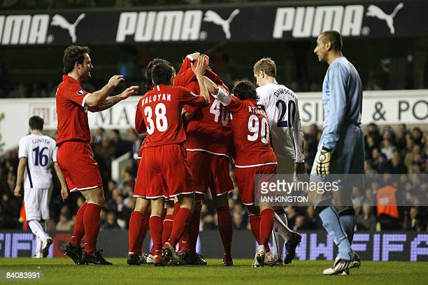 Spartak Moscow's Artem Dzuba celebrates after scoring with teammates against Tottenham Hotspurs during a UEFA Cup Group D match at White Hart Lane in...