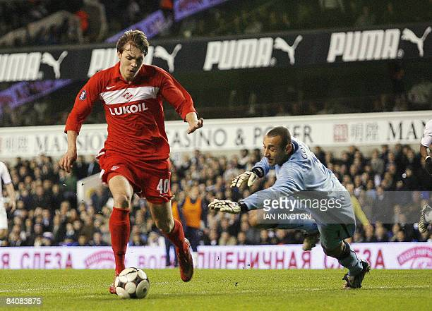 Spartak Moscow's Artem Dzuba dribbles the ball past Tottenham Hotspurs Brazilian goalkeeper Heurelho Gomes to score his second goal during a UEFA Cup...