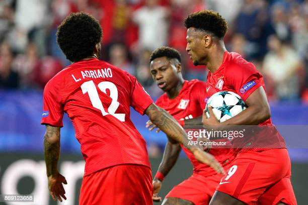 Spartak Moscow's Cape Verdean forward Ze Luis celebrates with teammates after scoring a goal during the UEFA Champions League group E football match...