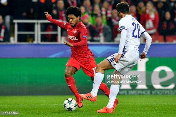 Spartak Moscow's forward from Brazil Luiz Adriano and Maribor's defender from Slovenia Mitja Viler vie for the ball during the UEFA Champions League...