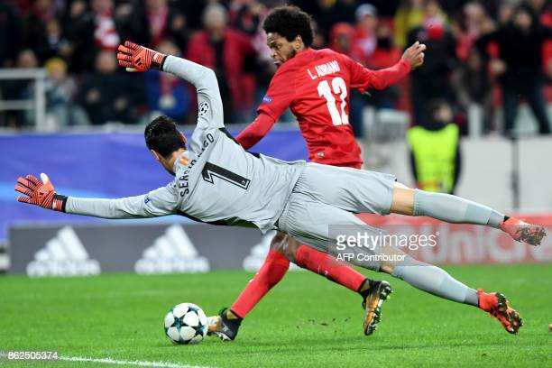 Spartak Moscow's forward from Brazil Luiz Adriano scores the team's fourth goal past Sevilla's goalkeeper from Spain Sergio Rico Gonzalez during the...