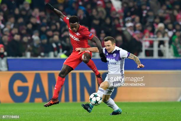 Spartak Moscow's forward from Netherlands Quincy Promes and Maribor's midfielder from Slovenia Dino Hotic vie for the ball during the UEFA Champions...
