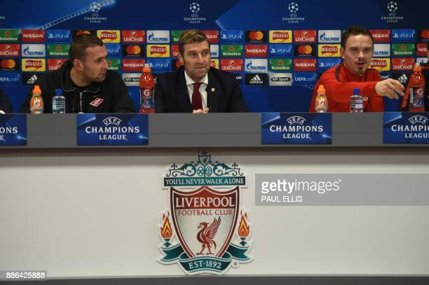 Spartak Moscow's Italian manager Massimo Carrera and Spartak Moscow's defender Andrey Eshchenko attend a press conference at Anfield stadium in...