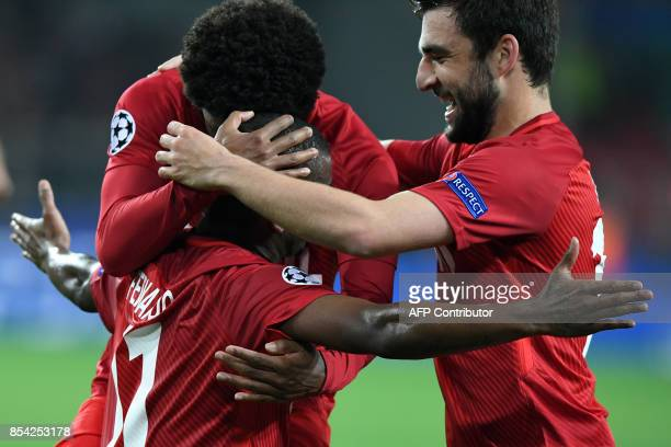 Spartak Moscow's midfielder from Brazil Fernando celebrates with teammates after scoring a goal during the UEFA Champions League Group E football...