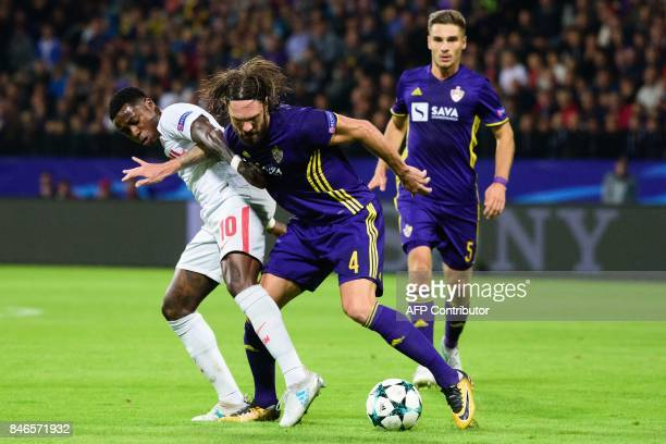 Spartak Moscow's Quincy Promes fights for the ball with NK Maribor's Marko Suler as Blaz Vrhovec looks on during the UEFA Champions League Group E...