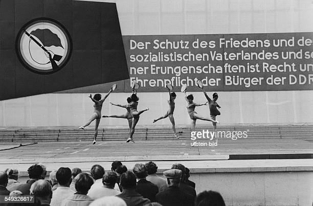 Spartakiad national sport event in the German Democratic Republic women gymnastic group performing in Halle/Saale