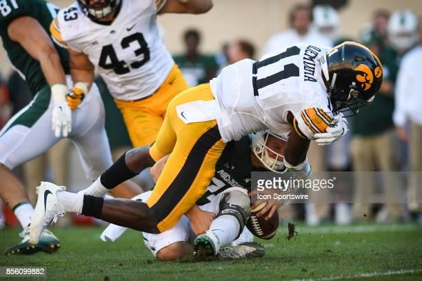 Spartans quarterback Brian Lewerke gets drilled by Hawkeyes cornerback Michael Ojemudia during a Big Ten Conference NCAA football game between...