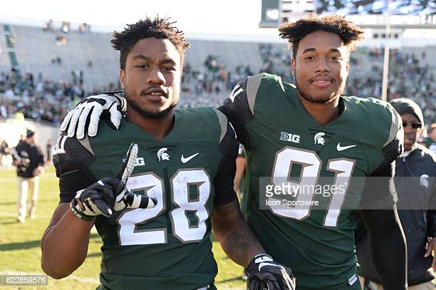 Spartans running back Madre London and defensive end Robert Bowers celebrate following a Big Ten Conference NCAA football game between Michigan State...