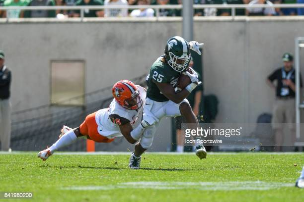 Spartans wide receiver Darrell Stewart Jr tries to break away from Falcons cornerback Cameron Jefferies during a nonconference college football game...
