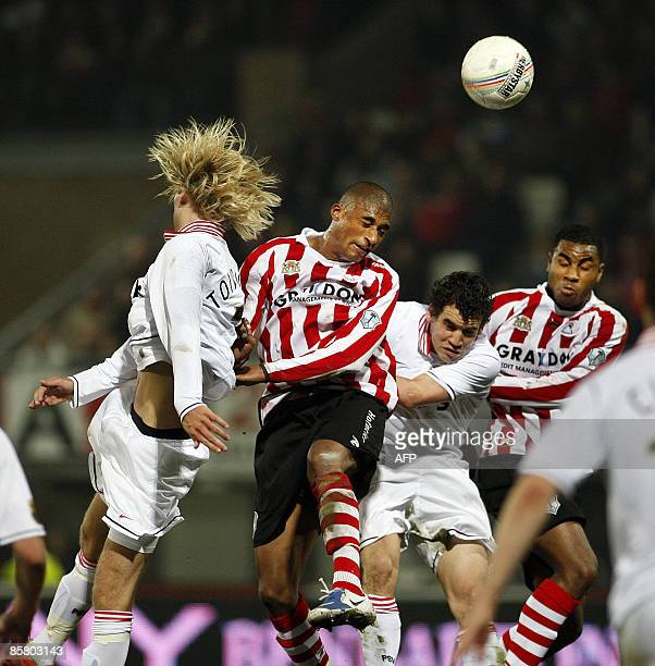Sparta's Jerold Promes wins a header against PSV eindhoven's Dirk Marcellis during the Premier League football match in Rotterdam on April 4 2009 AFP...