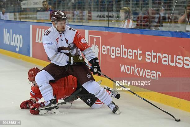 Sparta's Petr Vrana challenged by Cracovia's Michaela Kolarz during a Champions League Hockey match between KS Comarch Cracovia vs Sparta Prague at...