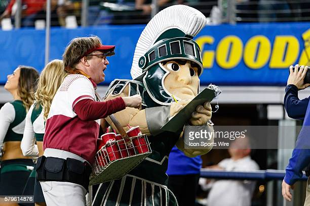 Sparty the Michigan State Spartans mascot signs the petition to have Larry the Dr Pepper vendor present the National Championship trophy during the...