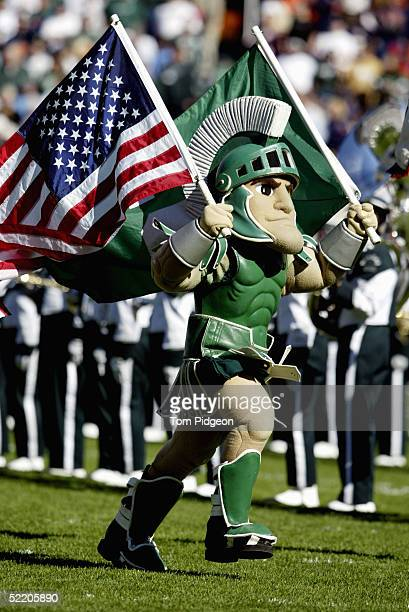 Sparty the Michigan State University Spartans mascot carries the American Flag during the game against the University of Illinois Fighting Illini at...