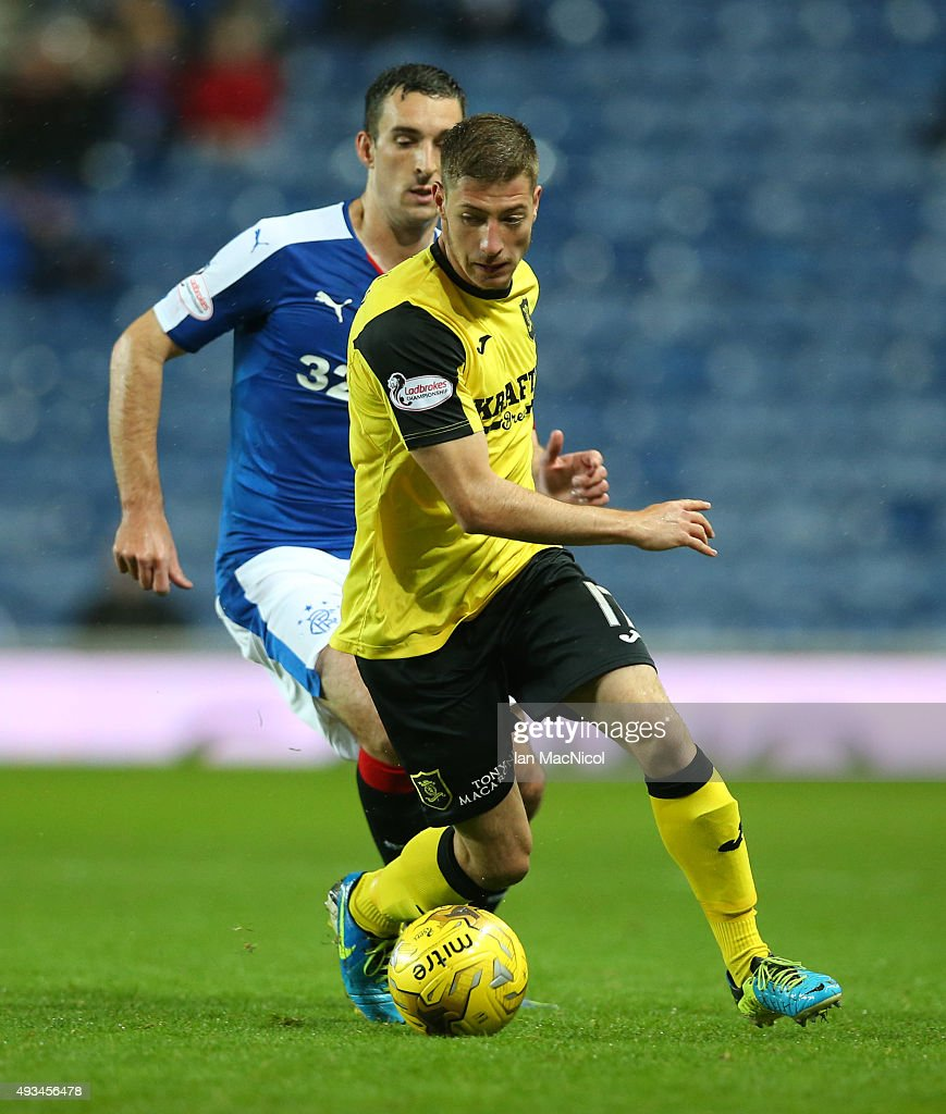 Spas Georgiev of Livingston vies with Lee Wallace of Rangers during the Petrofac Training Cup Quarter-Final match between Rangers and Livingston at Ibrox Stadium on October 20, 2015 in Glasgow, Scotland.