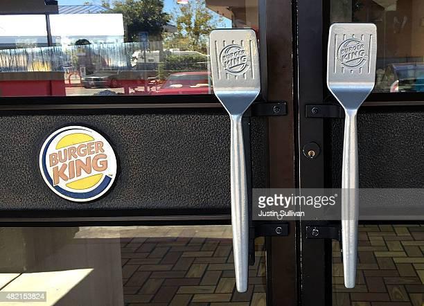 Spatula door handles are seen at a Burger King restaurant on July 27 2015 in San Rafael California Burger King parent company Restaurant Brands...