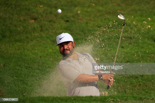 Spaun of the United States plays a shot from a bunker on the 18th hole during the final round of the Mayakoba Golf Classic at El Camaleon Mayakoba...