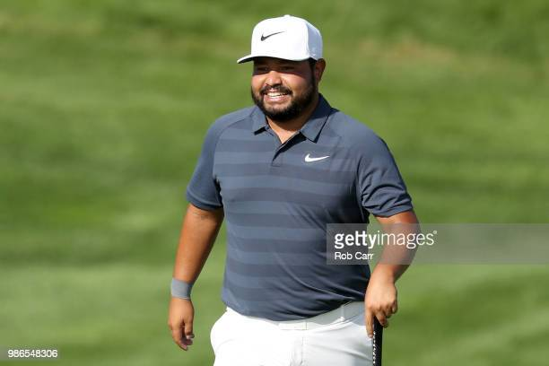 Spaun walks to the 16th green during the first round of the Quicken Loans National at TPC Potomac on June 28, 2018 in Potomac, Maryland.