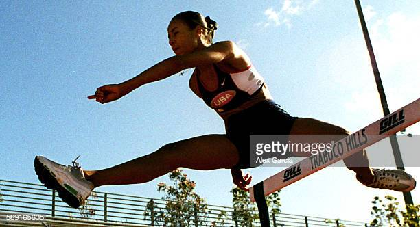 SPBethelleap0527AAG––Ashley Bethel track and field of Trabuco Hills high school shows her winning form during hurdle practice