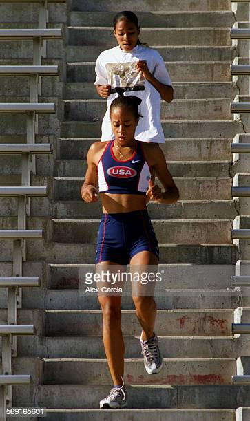SPBethelsis0527AAG––Ashley Bethel track–and– field star of Trabuco Hills high school is trailed during practice by her younger sister Morgan who has...