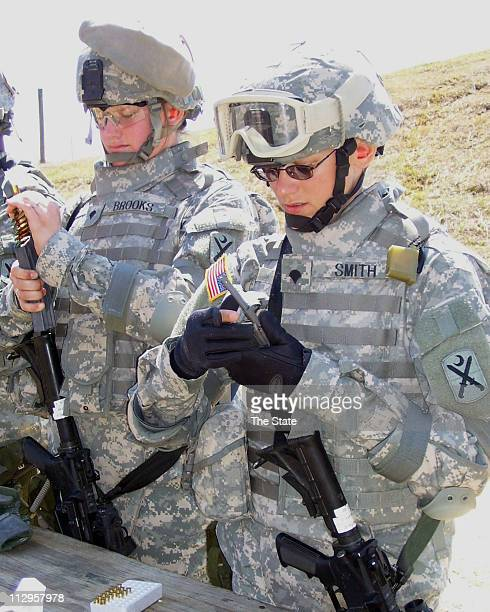 Spc Jasmine Brooks left and Spc Crystal Smith both combat medics and members of Company C 163rd Support Battalion load ammunition into magazines...