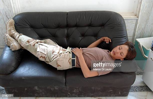 S Spc Johanna Landry from New York a medic attached to the Alfa Company 26 Infantry sleeps while off duty at her barrack in Saddam Hussein's...
