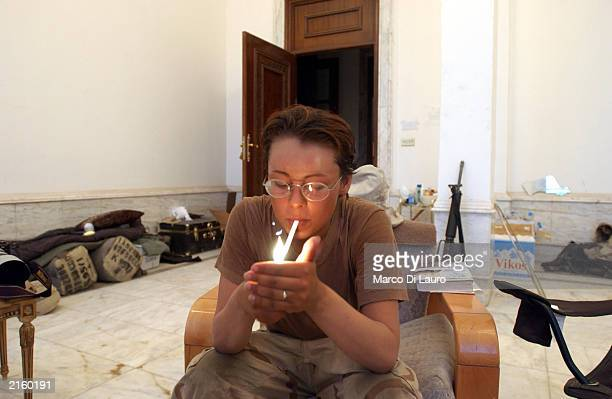 S Spc Johanna Landry from New York a medic attached to the Alfa Company 26 Infantry lights a cigarette as she rests after a patrol in her barrack in...