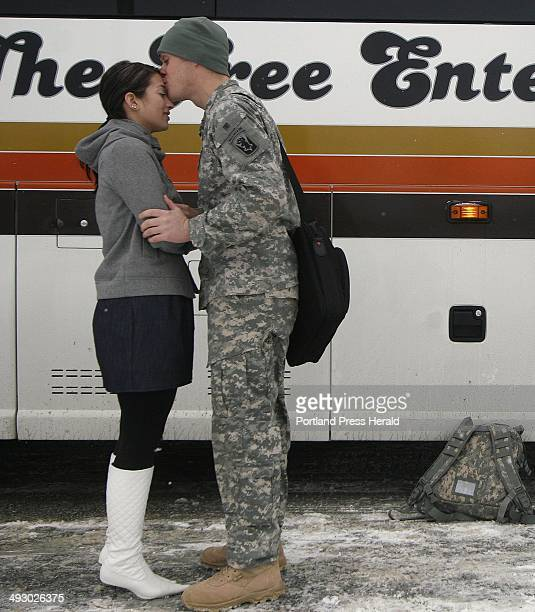 Spc Philip Flint of Sanford says goodbye Friday to girlfriend Megan Hernandez as 40 soldiers headed back to Indiana from the Maine Army National...