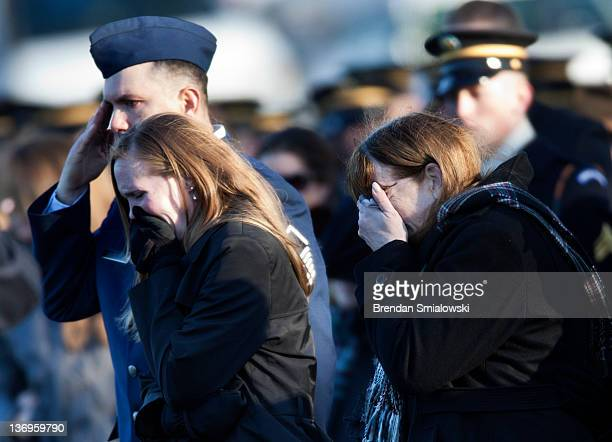 Spc Ronald H Wildrick Jr's brother Joe Osbourn sister Christie Berkey and mother Sandra McDonald listen as Taps is played during a burial service at...