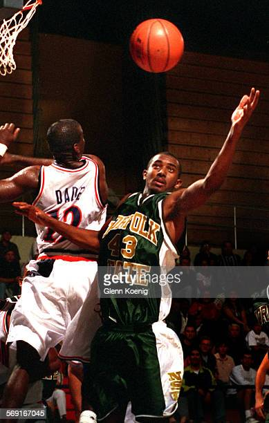 Chris1122GKChris Dade of the Titans goes for the ball against NorfolkÕs Darrell Neal During a college basketball game between Cal State Fullerton and...
