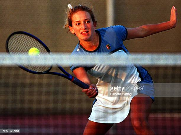 DanaTennis.Uhma.RH––111798––Dana Hills High's Alison Uhma reaches for a shot during Division I girls tennis quarterfinal playoff action vs. Newport...