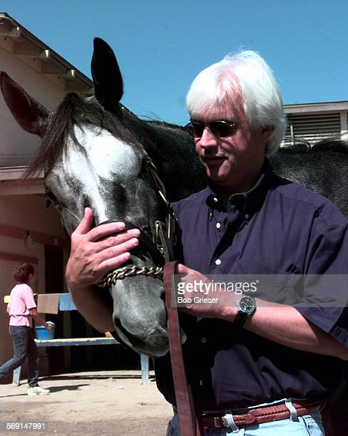 DelMar.Baffert.1.BG.6Aug97––Horse trainer Bob Baffert with stake horse Silver Charm in the back track area of Del Mar Race Track.