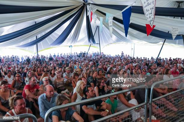 Speak Easy stage crowd watch Russell Kane's Evil Genius Live during Latitude Festival at Henham Park Estate on July 14 2018 in Southwold England