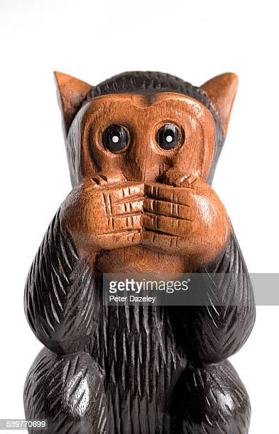 speak no evil monkey - sculpture stock pictures, royalty-free photos & images