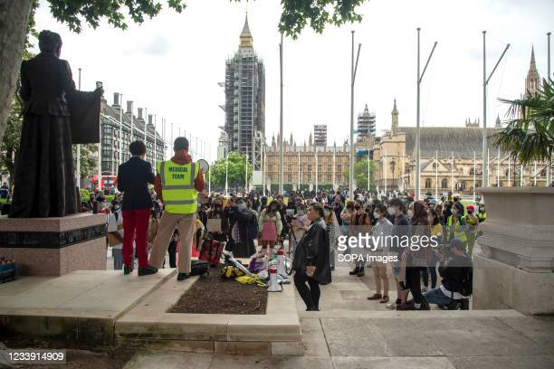 Speaker addresses protesters during a Stop Asian Hate protest at Parliament Square in London. Anti-Asian violence and abuse has escalated since the...