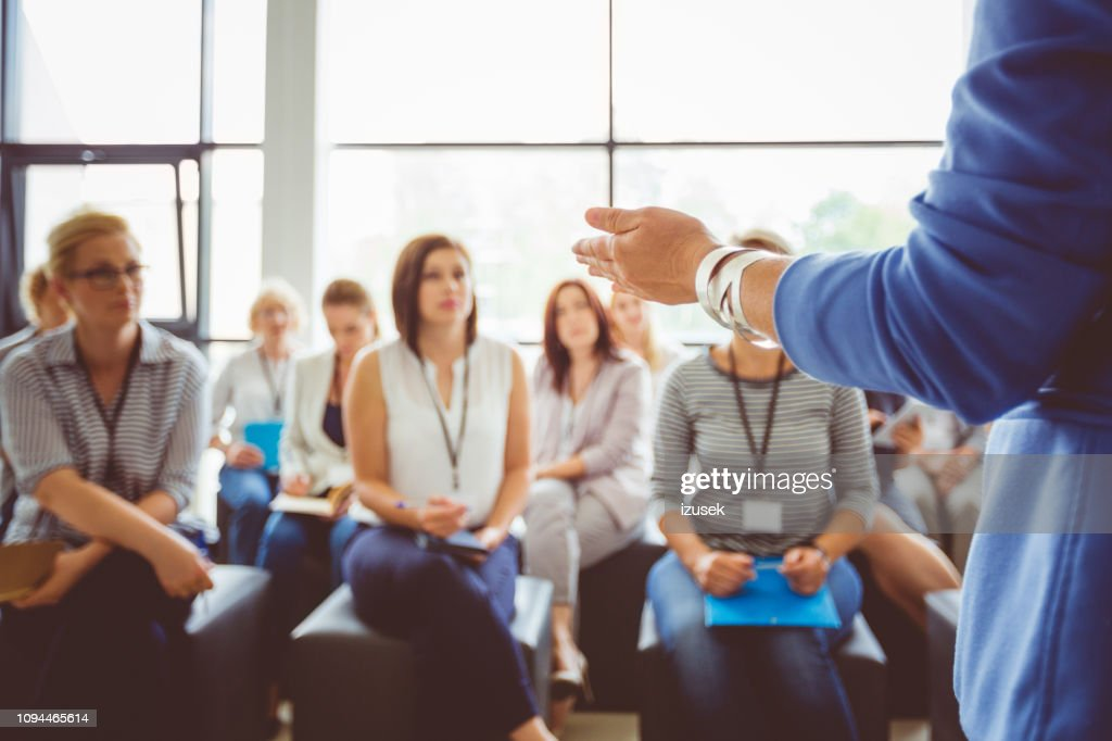 Speaker addressing group of females : Stock Photo