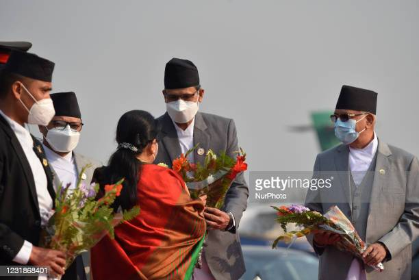 Speaker Agni Sapkota along with face mask give flower bouquet to farewell President Bidya Devi Bhandari for two-day official state visit to...