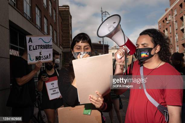 Speaker Anna Paula reads a letter from the Brazilian Left Front group to the Brazilian Ambassador during the demonstration. In Dublin, Ireland,...
