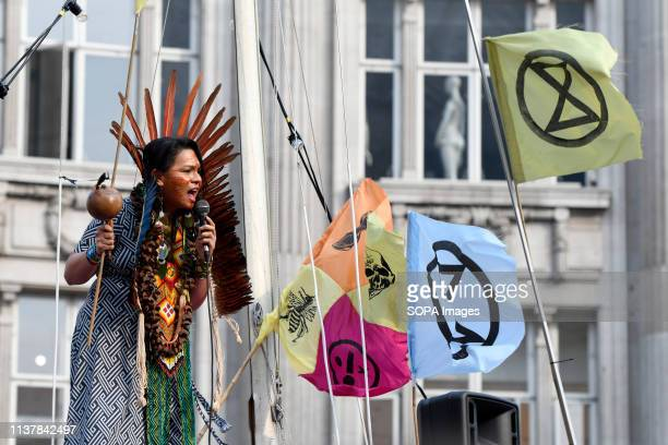 A speaker is seen addressing a speech during the Extinction Rebellion Strike in London Environmental activists from Extinction Rebellion movement...