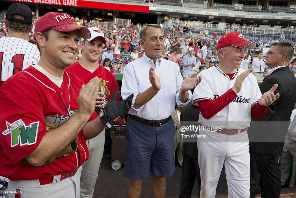Speaker John Boehner, R-Ohio, center, Reps. Marlin Stutzman, R-Ind., left, Adam Kinzinger, R-Ill., and Todd Platts, R-Pa., applaud the start of the 51st Annual CQ Roll Call Congressional Baseball Game held at Nationals Park. The Democrats over the Republicans prevailed 18-5.