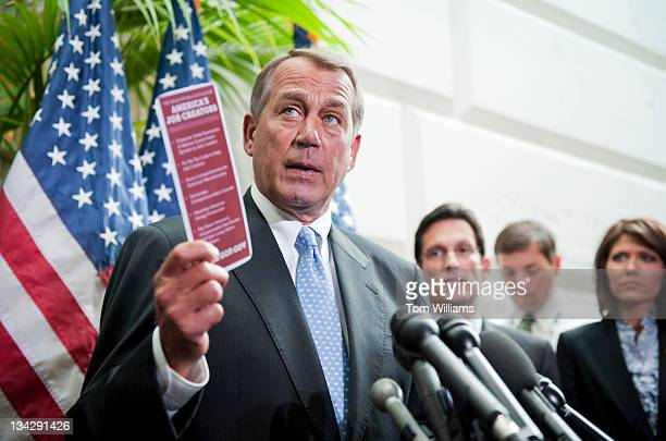 Speaker John Boehner ROhio holds up a pamphlet which outlines Republican's plan to create jobs during a news conference after a meeting of the House...