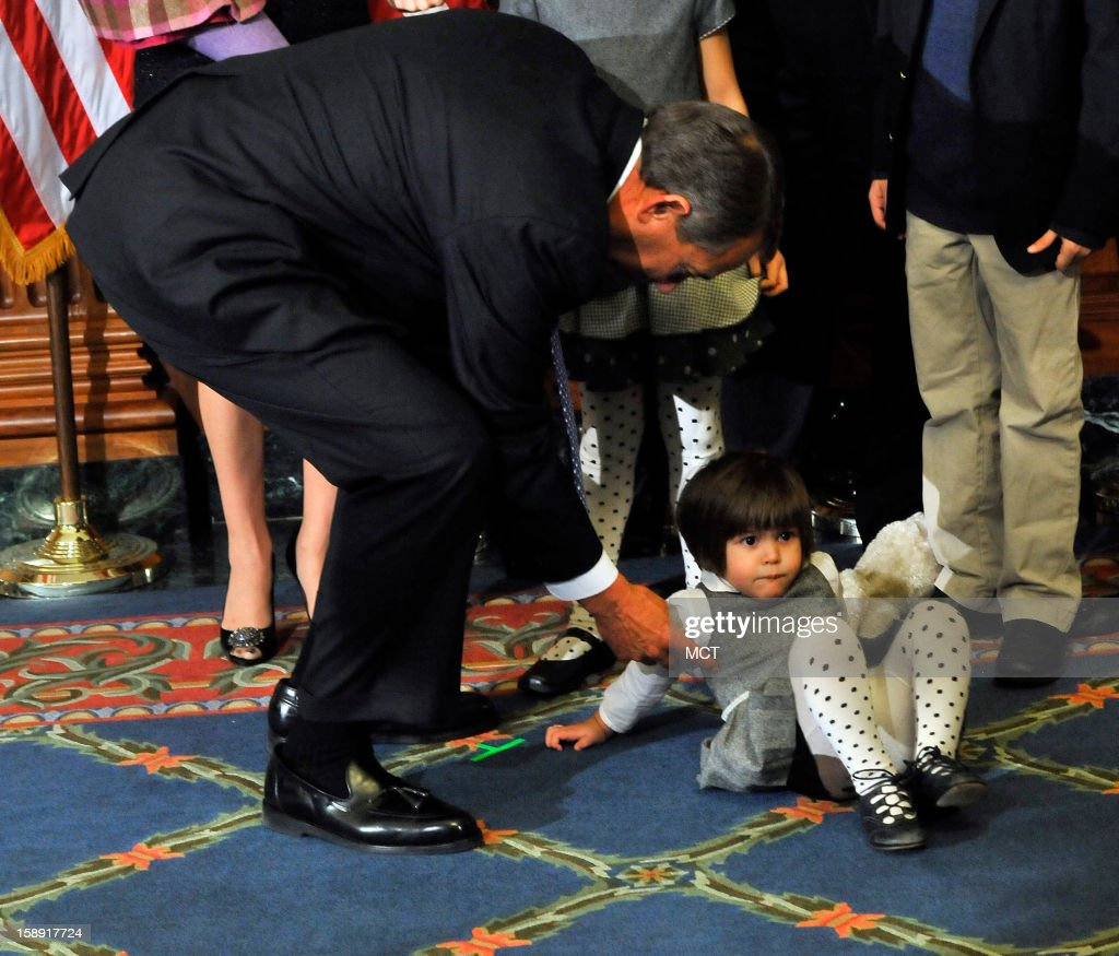 Speaker John Boehner trys to get the attention of Maria-Victoria Duffy, daughter of Rep. Sean Duffy, after at the swearing-in ceremony on Thursday, January 3, 2013, in Washington, D.C.