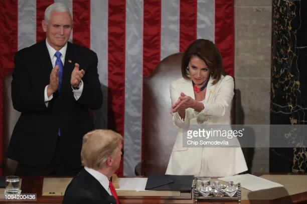 Speaker Nancy Pelosi and Vice President Mike Pence applaud President Donald Trump at the State of the Union address in the chamber of the US House of...